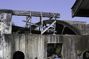 Sugar Cane being Crushed for Rum using a Waterwheel, Grenada.