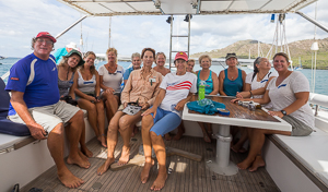 John and the ladies on Morgan's boat for the first race, Foulmouth Harbor, Antigua.