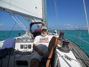 My Friend Bruce working hard.on passage from Miami to the Abacos