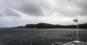 Cape Horn. The flag and station are in the center. The monument is just to the right of that on the next hill.