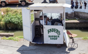 Barber at the market, Georgetown, Guyana